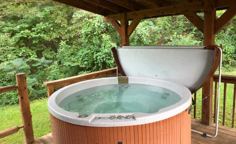 eureka springs cabin with outdoor hot tub