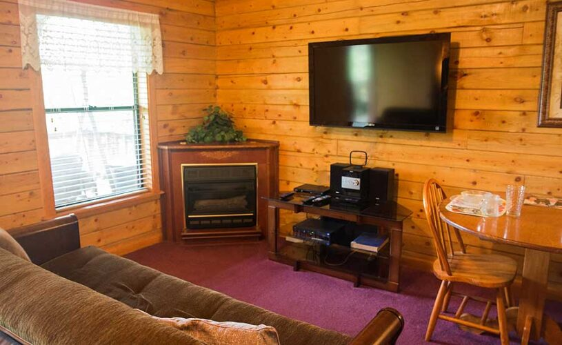 mountain top cabin 1 living room with tv and gas fireplace