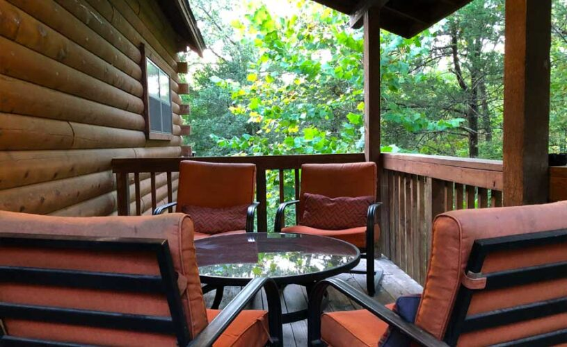 shady oak cabin deck with patio furniture