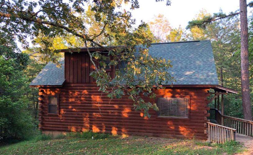 shady oak cabin at dusk