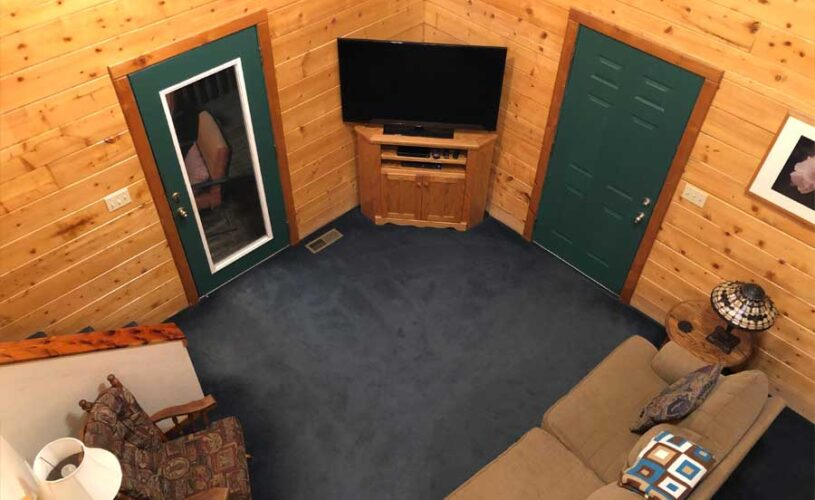 shady oak cabin living room from above