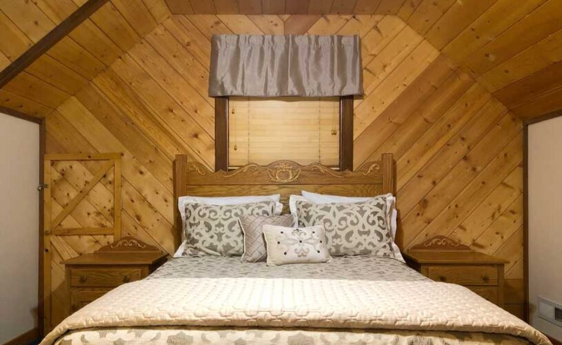 shady oak cabin loft bedroom with queen bed